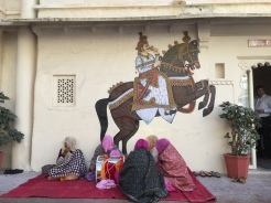 6. Local wall mural and women in saris and shawls